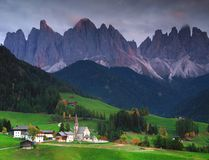 The church Santa Maddalena with the impressive Odle Mountains Group in the background at sunset. royalty free stock images