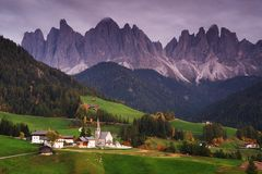 The church Santa Maddalena with the impressive Odle Mountains Group in the background at sunset. royalty free stock photography