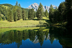 Odle reflected in the lake, Italy. Lake along the hiking trail to the Odle Group, Dolomites - Italy royalty free stock photography