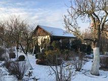 Odlingslottar i snöig vinter Arkivfoto