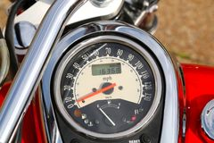Odometer Gauge of a Custom Red Cruiser Motorcycle Stock Image