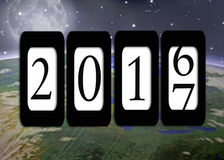 Odometer for New Year 2017 on planet Earth Stock Image