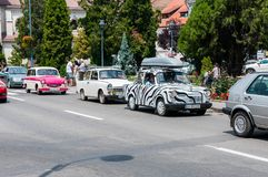Odorheiu Secuiesc, Romania- 07 July 2018: White Trabant 601 with black stripes  at the local veteran car show. Odorheiu Secuiesc, Romania- 07 July 2018 Stock Images