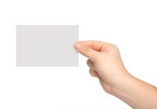 Odosobniona mężczyzna ręka trzyma kawałek papieru zdjęcie royalty free