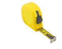 odosobniona miara pomiarowego taśmy narzędzia biel kolor żółty Fotografia Stock
