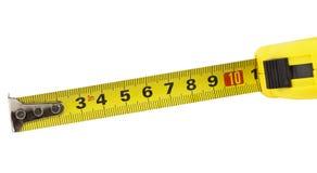 odosobniona miara pomiarowego taśmy narzędzia biel kolor żółty Zdjęcie Royalty Free