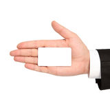 Odosobniona ręka biznesmen trzyma białą wizytówkę fotografia stock