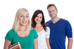 Odosobniona szczęśliwa grupa młodzi uśmiechnięci ludzie jak ucznie lub tr Obraz Stock