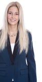 Odosobnionej młodej blondynki uśmiechnięty bizneswoman w kostiumu nad białym b Zdjęcia Stock
