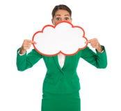 Odosobniony bizneswoman w zielonym mienie bielu podpisuje wewnątrz ręki Fotografia Stock