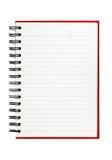 Odosobniony czerwony notatnik zdjęcie stock