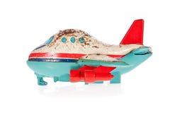 odosobniony dżetowy stary samolotu cyny zabawki biel obraz royalty free