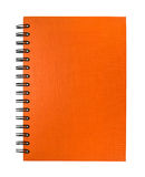 Odosobniony pomarańczowy notatnik fotografia stock
