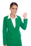 Odosobniony szczęśliwy bizneswoman w zieleni pokazuje coś z ona Obraz Stock