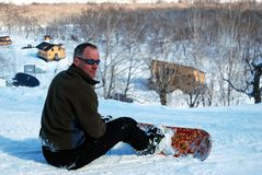 odpoczynkowy snowboarder fotografia stock
