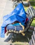 Odpoczywać przy ławką Zdjęcie Stock