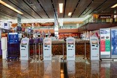 Odpraw maszyny przy Changi lotniskiem w Singapur Fotografia Stock