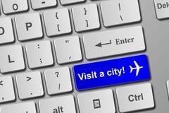 Odwiedza miasto błękitnego klawiaturowego guzika Zdjęcia Stock