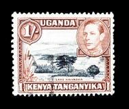 Odwoływający znaczek pocztowy drukujący Uganda, Kenja i Tanganyika, zdjęcia stock