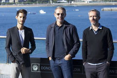 The Odyssey. Actors Pierre Niney, Lambert Wilson and Director Jérôme Salle presenting the film The Odyssey (L´Odysseé) at the 64 Edition of San Sebastian Royalty Free Stock Image