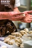 Odziena / Latvia - August 24th, 2018: Male Chef Preparing Bread Dough for Selfmade Bread and Patties stock photography