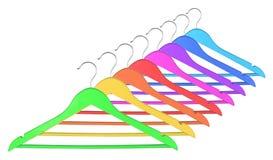 odziewa kolorowych wieszaki Zdjęcia Stock