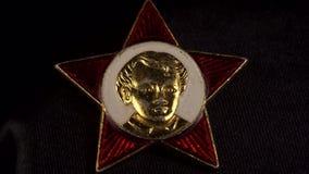 Odznaka Octobrist, Radzieccy symbole, zapoczątkowywa 4K Obraz Royalty Free
