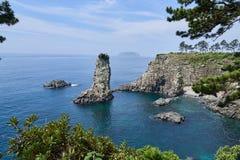 Oedolgae风暴岩石和小山在济州海岛 库存照片