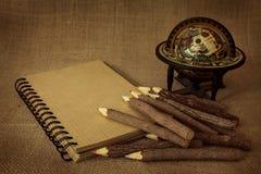 Oefenboek met potloden Royalty-vrije Stock Foto