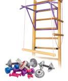Oefeningsmateriaal tegen de achtergrond van de huisgymnastiek Stock Foto