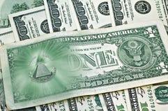 Oeil de Providence, faisceaux au-dessus des billets de banque cent dollars Photographie stock
