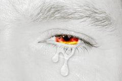 Oeil pleurant avec le drapeau de l'Allemagne Photo libre de droits