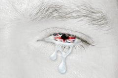 Oeil pleurant avec le drapeau du Royaume-Uni Photos stock