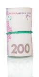 Oekraïens geld UAH 200 in geïsoleerd rubber broodje in entrepot Stock Foto
