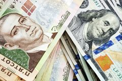 Oekraïense hryvna en Amerikaanse dollars De uitwisseling van de munt Stock Foto