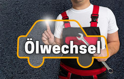 Oelwechsel (in german oil change) touchscreen is operated by car Stock Photos