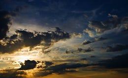 oerhörd skysolnedgång Royaltyfria Bilder