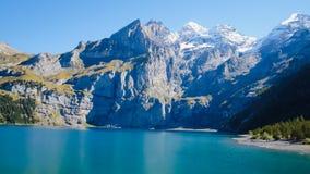 Oeschinensee - Oeschinen lake. The panorama in summer Mountain in Oeschinensee Oeschinen lake Royalty Free Stock Image