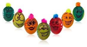 Oeuf de pâques, peint dans le visage de sourire de bande dessinée du type Décoré par exemple Photo stock