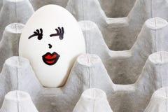 Oeuf peint par visage Image libre de droits