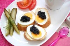 Oeufs avec le caviar Photos libres de droits