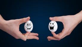 Oeufs avec les visages souriants Image stock
