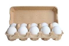 Oeufs blancs dans une boîte pour des oeufs Image libre de droits