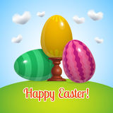 Oeufs bleus de l'affiche trois heureux de Pâques Photographie stock