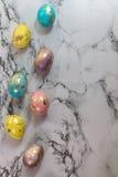 Oeufs d'or de Pâques de peinture Photographie stock libre de droits