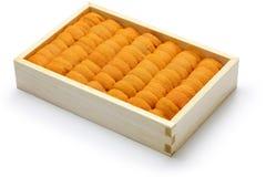 Oeufs d'oursin, sushi japonais et ingrédients de sashimi Images stock