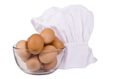 Oeufs de Brown et chapeau de chef Photos stock