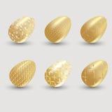 Oeufs de pâques d'or avec l'ombre sur le fond gris Photo stock