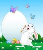 Oeufs de pâques de peinture de lapin de Pâques illustration libre de droits