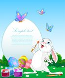 Oeufs de pâques de peinture de lapin de Pâques